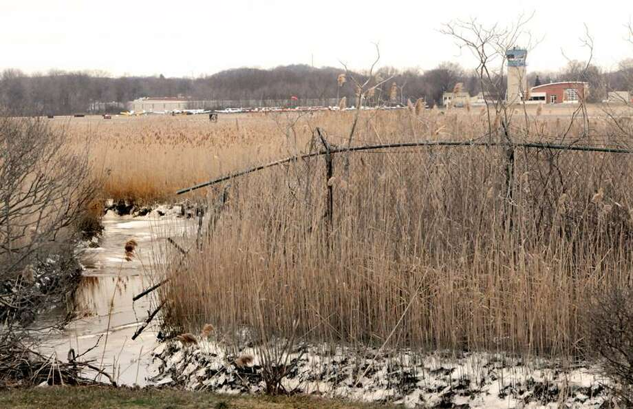 A fence around Tweed-New Haven airport that stops by a stream near Dean Street and Morris Causeway in New Haven January 25, 2013.  Peter Hvizdak / New Haven Register Photo: New Haven Register / ©Peter Hvizdak /  New Haven Register