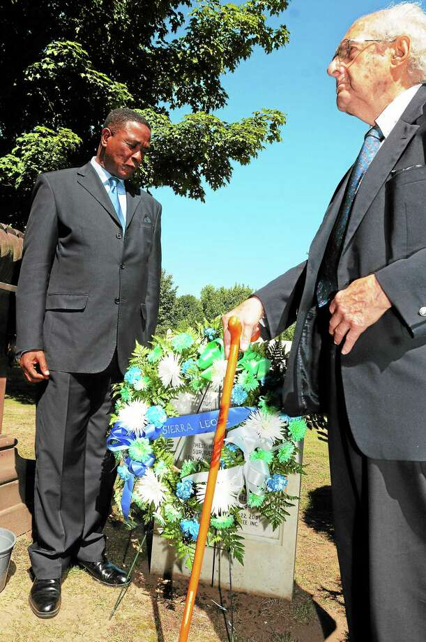 (Photo by Peter Hvizdak — Register)Alpha Kanu, spokesman for the President of Sierra Leone, left, and Al Marder, President of the Amistad Committee, lay a wreath at the memorial to 6  La Amistad captives who survived the  voyage from Cuba but died of grave illness in New Haven 1839, during a Memorial Service for the six Amistad Captives Friday, September 20, 2013 at the Grove Street Cemetery in New Haven, Conn. commemorating the 25th Anniversary of the Amistad Committee, Inc. Photo: New Haven Register / ©Peter Hvizdak /  New Haven Register