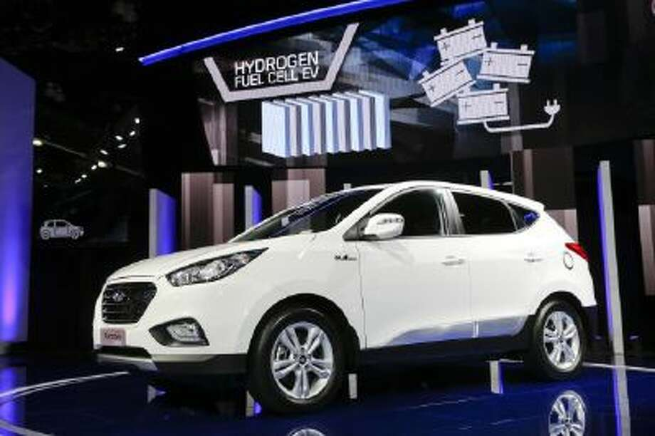 The 2015 Hyundai Tucson Fuel Cell hydrogen-powered electric vehicle is introduced at the auto show in Los Angeles on Nov. 20.