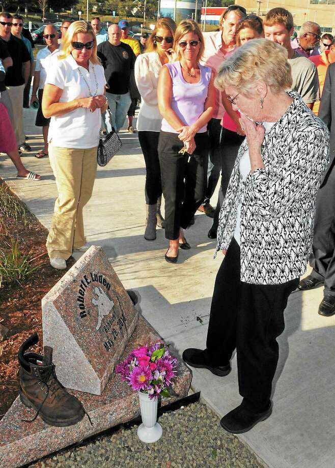 Annie Luden of East Haven, right, with family and friends, rear, Friday at the West Haven Railroad Station during the unveiling of a memorial for her son, Robert E. Luden, a railroad worker who was killed by a train. Photo: Photo By Peter Hvizdak — New Haven Register   / ©Peter Hvizdak /  New Haven Register
