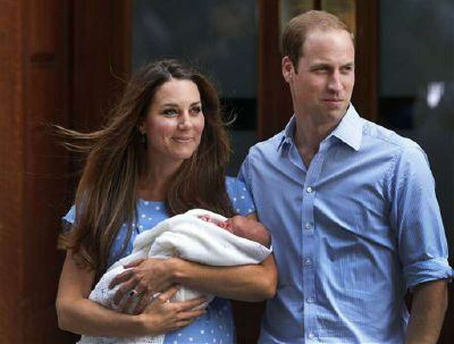 Britain's Prince William, right, and Kate, Duchess of Cambridge hold the Prince of Cambridge, Tuesday July 23, 2013, as they pose for photographers outside St. Mary's Hospital exclusive Lindo Wing in London where the Duchess gave birth on Monday July 22. The Royal couple are expected to head to London's Kensington Palace from the hospital with their newly born son, the third in line to the British throne. (AP Photo/Lefteris Pitarakis) Photo: AP / AP