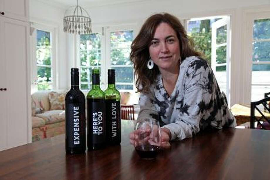 Alexis Swanson Traina at her home in San Francisco, Calif., on Friday, Nov. 15, 2013 with her new line of inexpensive wine that has recently made Oprah's list of favorite things. Photo: The Oakland Tribune / NO SALES/MAGSOUT/LOCALS PLEASE CREDIT/ONLINE OK