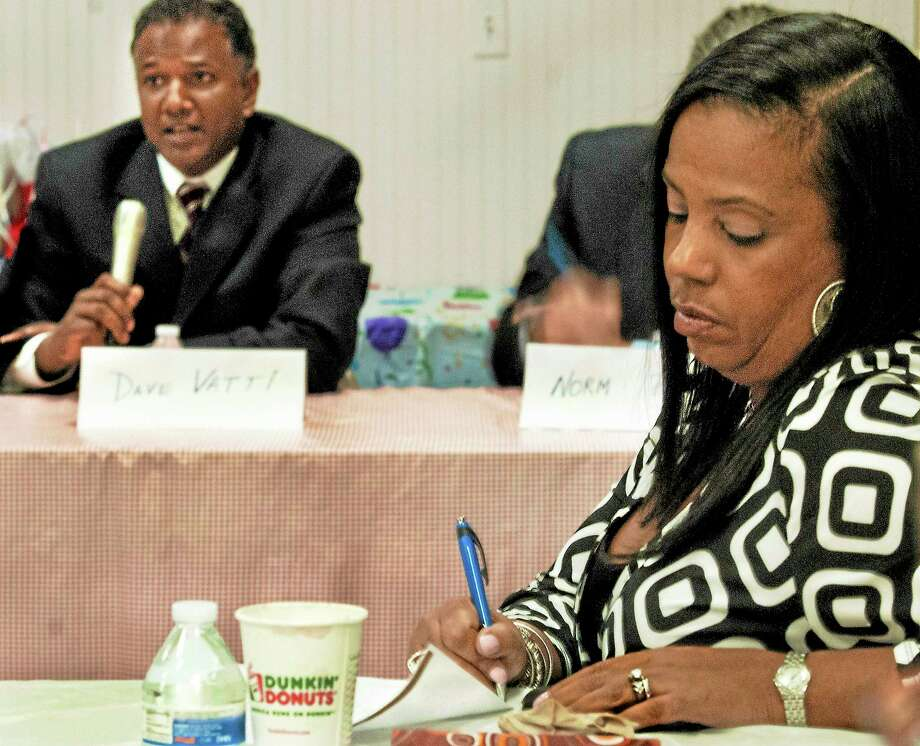 Dori Dumas, 1st Vice-President of the NAACP Greater New Haven Branch, takes notes as she listens to Dave Vatti, an assistant U.S. attorney in Connecticut who was a panalist Thursday for a discussion on the Justice Department's new federal incarceration policies. Photo: Melanie Stengel — New Haven Register