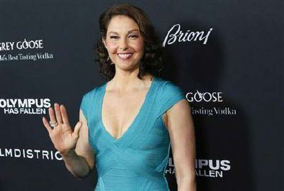 "Cast member Ashley Judd arrives at the premiere of the movie ""Olympus Has Fallen"" at the ArcLight Cinema in Hollywood, California March 18, 2013."