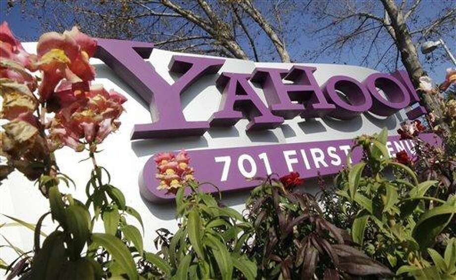 The company logo is displayed at Yahoo headquarters in Sunnyvale, Calif. One of Britain's youngest Internet entrepreneurs has hit the jackpot after selling his top-selling mobile application Summly to search giant Yahoo the company announced Monday March 25, 2012.  AP Photo/Paul Sakuma Photo: AP / AP