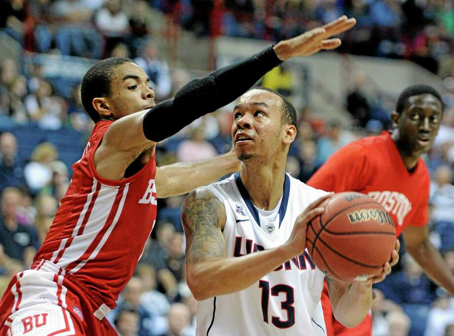 UConn's Shabazz Napier grew up in the Boston area, but Boston College didn't attempt to recruit him until late in the process. Now the Huskies will play the Eagles for the first time in nine years. Photo: Fred Beckham — The Associated Press   / FR153656 AP