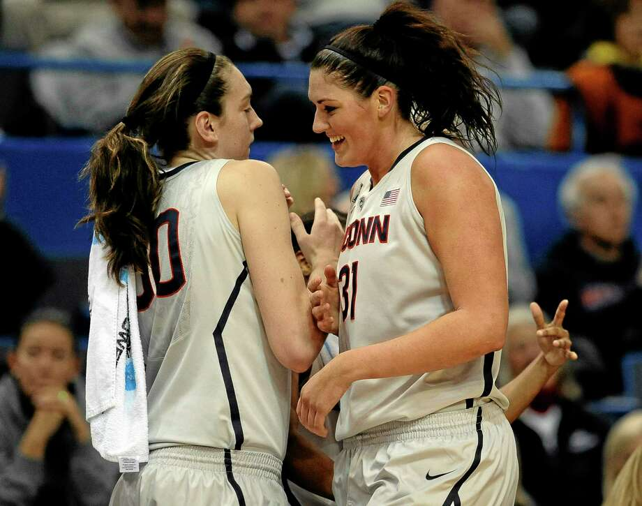 UConn's Stefanie Dolson, right, is greeted by teammate Breanna Stewart after completing a triple-double in Wednesday's 114-68 win over Oregon. Photo: Jessica Hill — The Associated Press   / FR125654 AP