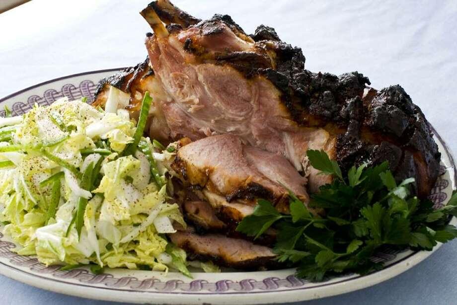 Matthew Mead/Associated Press photo: Hoisin-Glazed Ham With Napa Cabbage-Snow Pea Slaw Photo: AP / AP2013