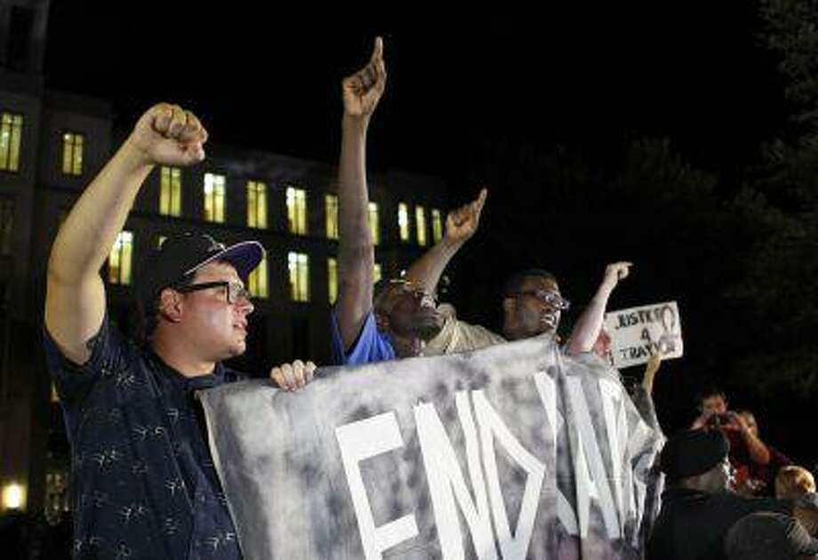 Demonstrators react to the verdict outside Seminole County Court where George Zimmerman was found not guilty on second-degree murder and manslaughter charges in Sanford, Florida July 13, 2013. Photo: REUTERS / X00507