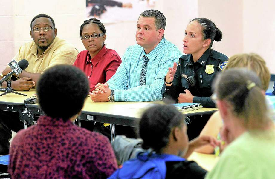 Town officials and police talk with residents concerned about crime in the upper Whalley/Westville areas during a meeting at Mauro-Sheridan Interdistrict Magnet School Thursday evening. Pictured are, from left, Alderman Brian Wingate, D-29; Alderwoman Angela Russell, D-27; New Haven police Sgt. Robert Lawlor Jr.; and Sgt Renee Forte. Photo: Peter Casolino — New Haven Register