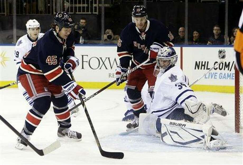 Toronto Maple Leafs goalie James Reimer (34) stops a shot on goal by New York Rangers' Arron Asham (45) during the second period of an NHL hockey game, Saturday, Jan. 26, 2013, in New York. (AP Photo/Frank Franklin II) Photo: AP / AP