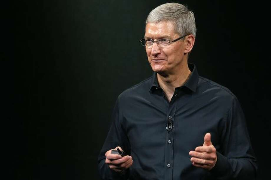 Apple CEO Tim Cook speaks on stage during an Apple product announcement at the Apple campus on September 10, 2013 in Cupertino. (Justin Sullivan/Getty Images) / 2013 Getty Images
