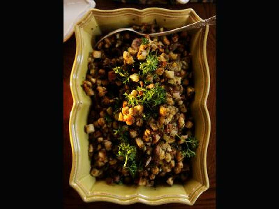 """The stuffing from the """"Tomsgiving"""" classics of Tom Ryan who started Smashburger and Tom's Urban 24 at his Denver home on Saturday, November 9, 2013. / Copyright - 2013 The Denver Post, MediaNews Group."""