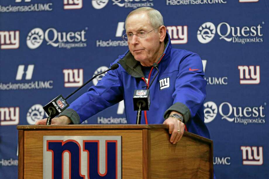Giants head coach Tom Coughlin talks to the media during an availability before the start of practice on Wednesday in East Rutherford, N.J.  The Giants announced Wednesday that Coughlin's brother, John, died on Monday night at Hackensack University Medical Center. He was 63. There was no cause of death listed, but a funeral home handling the arrangements said the death was unexpected. Photo: Julio Cortez — The Associated Press   / AP