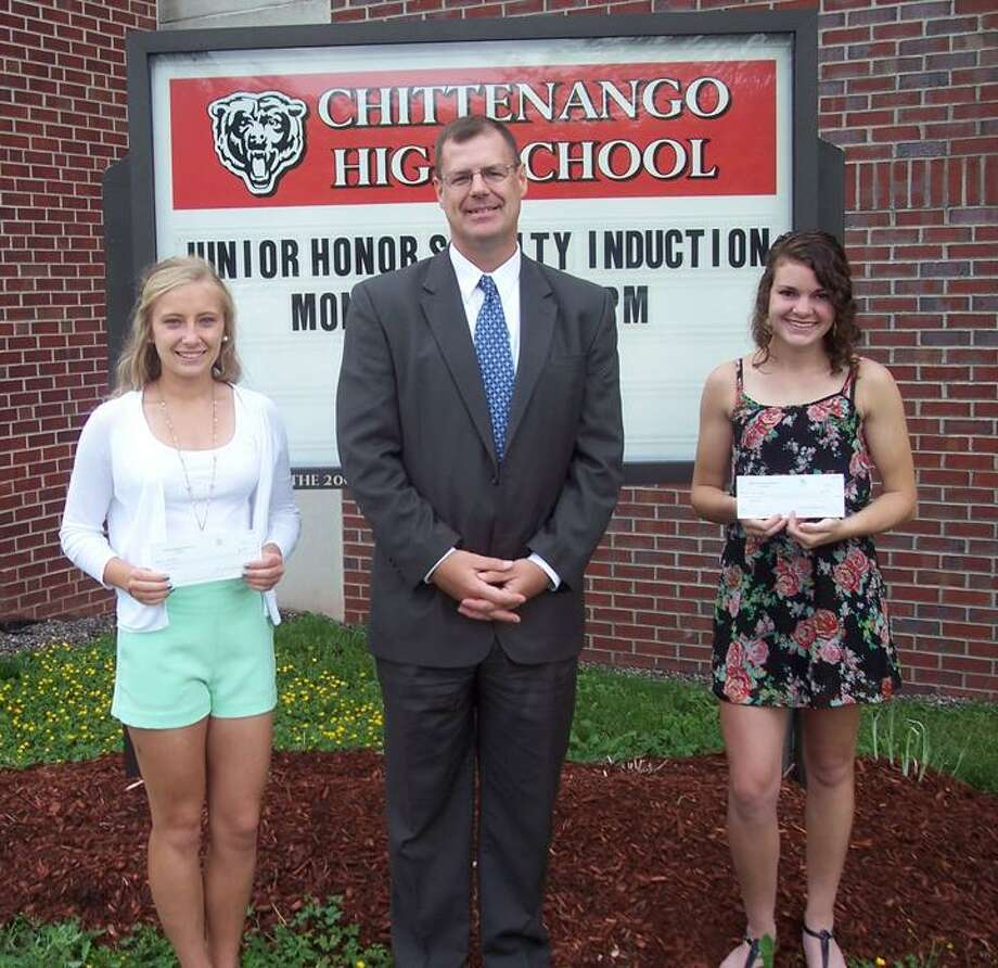 Photo Courtesy Sullivan Community Council Maddie SeGuin and Emily Gibbons receive their Sullivan Community Council scholarship awards from board treasurer Bob Markowski.