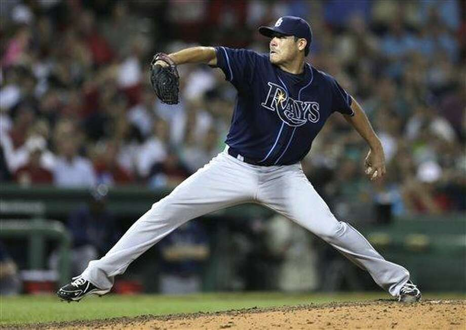 Tampa Bay Rays starting pitcher Matt Moore delivers to the Boston Red Sox during the seventh inning of a baseball game at Fenway Park, Monday, July 22, 2013, in Boston. (AP Photo/Charles Krupa) Photo: AP / AP