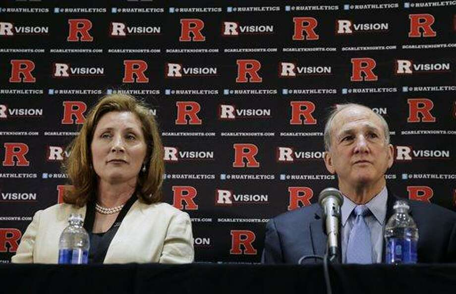 Julie Hermann, left, sits with Rutgers president Roberet L. Barchi, as they listen to a question during a news conference where she was introduced as the new athletic director at Rutgers University on Wednesday, May 15, 2013, in Piscataway, N.J.  Hermann was a senior associate athletic director and senior woman administrator at the University of Louisville. Rutgers has been looking for a new AD since Tim Pernetti resigned on April 5, part of the fallout from the Mike Rice scandal. (AP Photo/Mel Evans) Photo: AP / AP