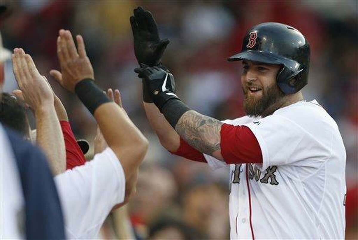 Boston Red Sox's Mike Napoli celebrates his solo home run in the first inning of a baseball game against the Philadelphia Phillies in Boston, Monday, May 27, 2013. (AP Photo/Michael Dwyer)