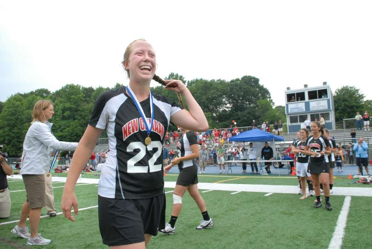 Kacie Pippitt #22 of New Canaan High School, smiles just after receiving her state championship medal as New Canaan defeated Greenwich High School 10-9 in the 2010 Girls Lacrosse State Division 1 Finals at Bunnell High School, Stratford, Saturday afternoon, June 12, 2010.