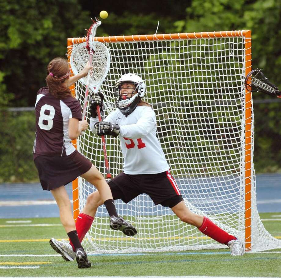 Olivia Hompe, #8, of New Canaan High School, left,  scores the lst goal of the game against Greenwich High School goalie, Kaitlin Bedford, # 51, during the 2010 Girls Lacrosse State Division 1 Finals at Bunnell High School, Stratford, Saturday afternoon, June 12, 2010.  New Canaan won the championship over GHS, 10-9. Photo: Bob Luckey / Greenwich Time