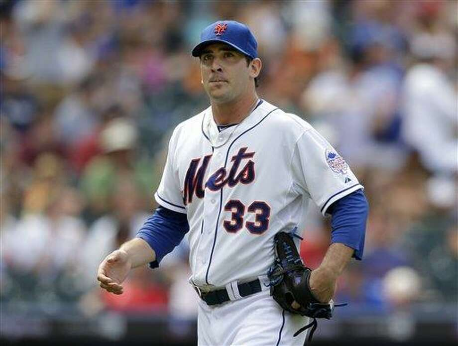 New York Mets starting pitcher Matt Harvey  leaves the mound in the sixth inning of a baseball game against the Philadelphia Phillies, Sunday, July 21, 2013, in New York. (AP Photo/Kathy Willens) Photo: AP / AP