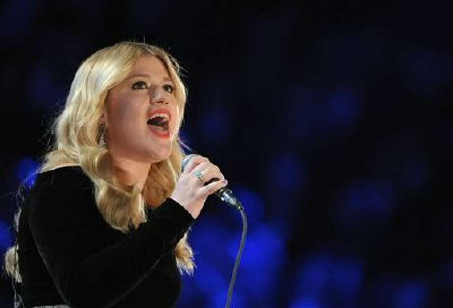 "In this Feb. 10, 2013 file photo, Kelly Clarkson performs on stage at the 55th annual Grammy Awards, in Los Angeles. NBC says Robin Williams, Whoopi Goldberg and William Shatner are among those joining Kelly Clarkson's holiday special. The special, titled ""Kelly Clarkson's Cautionary Christmas Music Tale,"" also is set to include country stars Blake Shelton, Reba McEntire and Trisha Yearwood, NBC said Wednesday, Nov. 20. Clarkson's special is scheduled to air 10 p.m. EST Dec. 11 on NBC. Photo: John Shearer/Invision/AP / Invision"