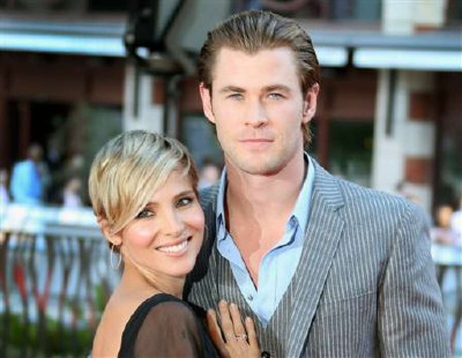 """This Sept. 2, 2013 file photo shows Spanish actress Elsa Pataky , left, and her husband, Australian Chris Hemsworth at the World Premiere of """"Rush"""" at a central London cinema in Leicester Square. Photo: Joel Ryan/Invision/AP / Invision"""