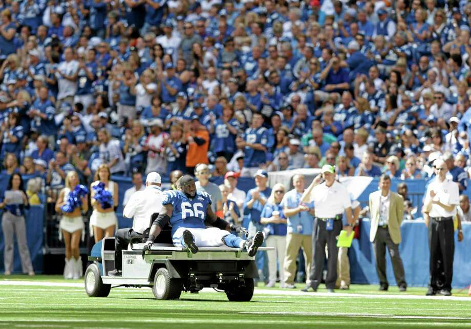 The Colts' Donald Thomas is carted off the field after getting injured during the first half Sunday against the Miami Dolphins in Indianapolis. Photo: Michael Conroy — The Associated Press   / AP