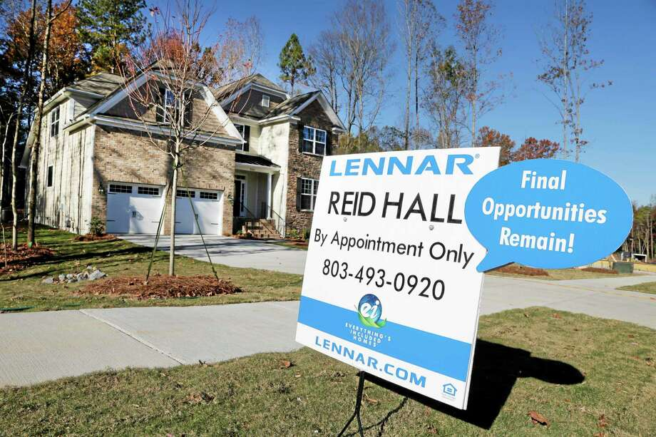 A home is advertised for sale in Matthews, N.C. The National Association of Realtors reported that home re-sales fell 3.2 percent last month from September to a seasonally adjusted annual pace of 5.12 million. Photo: Chuck Burton — The Associated Press   / AP