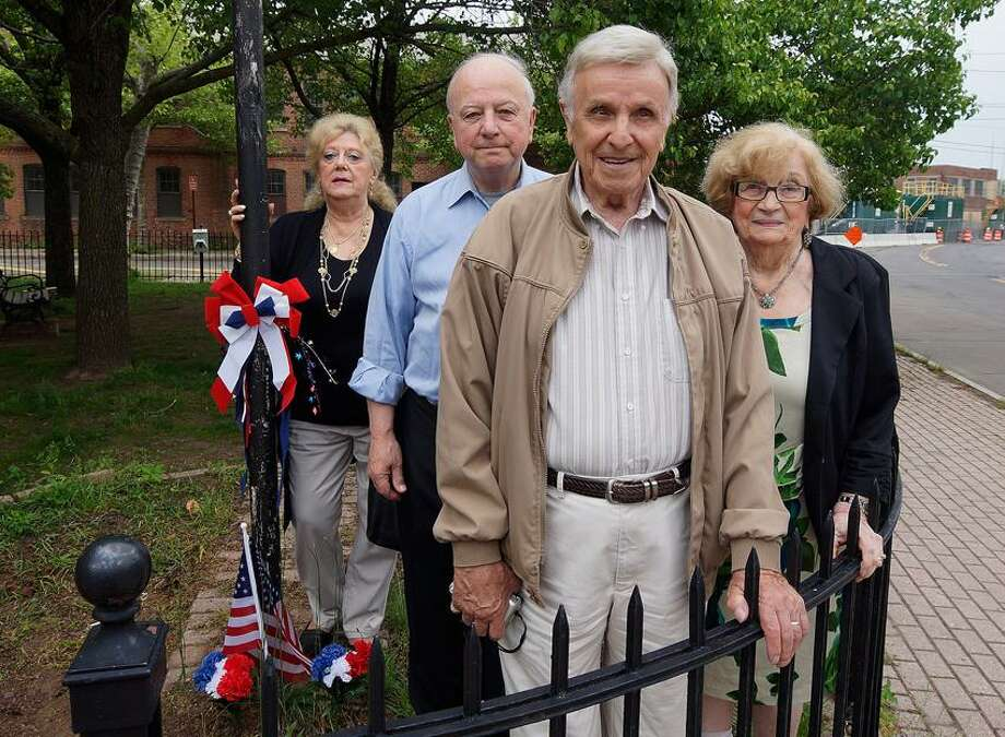 """New Haven-- This group has worked with the city to try and get the War Memorial replaced at Traingle Park in New Haven. They are, left to right; Mary Notarino, Bob Fodero, a Korean era veteran, Saverio Nero, a WWII veteran, his wife Adele Nero.  Photo-Peter Casolino/Register <a href=""""mailto:pcasolino@newhavenregister.com"""">pcasolino@newhavenregister.com</a>"""