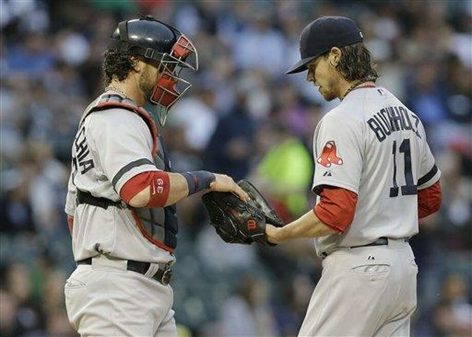 Boston Red Sox catcher Jarrod Saltalamacchia, left, talks with starter Clay Buchholz during the first inning of a baseball game against the Chicago White Sox in Chicago, Wednesday, May 22, 2013. (AP Photo/Nam Y. Huh) Photo: AP / AP
