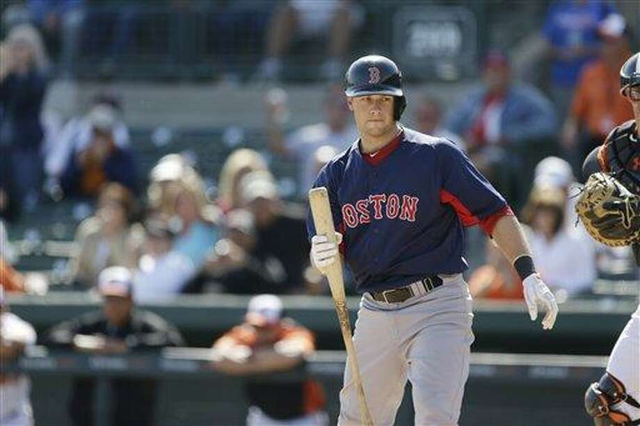 Boston Red Sox' Daniel Nava walks back to the dugout after striking out during the ninth inning of an exhibition spring training baseball game against the Baltimore Orioles, Monday, March 25, 2013 in Sarasota, Fla. (AP Photo/Carlos Osorio) Photo: AP / AP