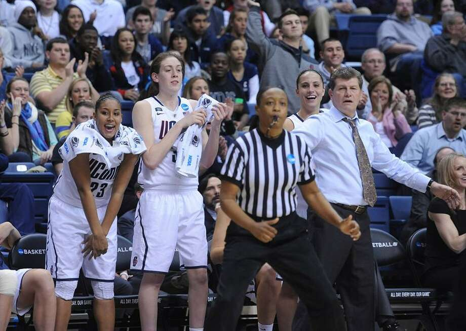 """Storrs-- NCAA Division I Women's Basketball Championship. UCONN's Kaleena Mosqueda-Lewis along with Breanna Stewart and coach Geno Auriemma react to a basket waining seconds of the game.  Photo-Peter Casolino/Register <a href=""""mailto:pcasolino@newhavenregister.com"""">pcasolino@newhavenregister.com</a>"""