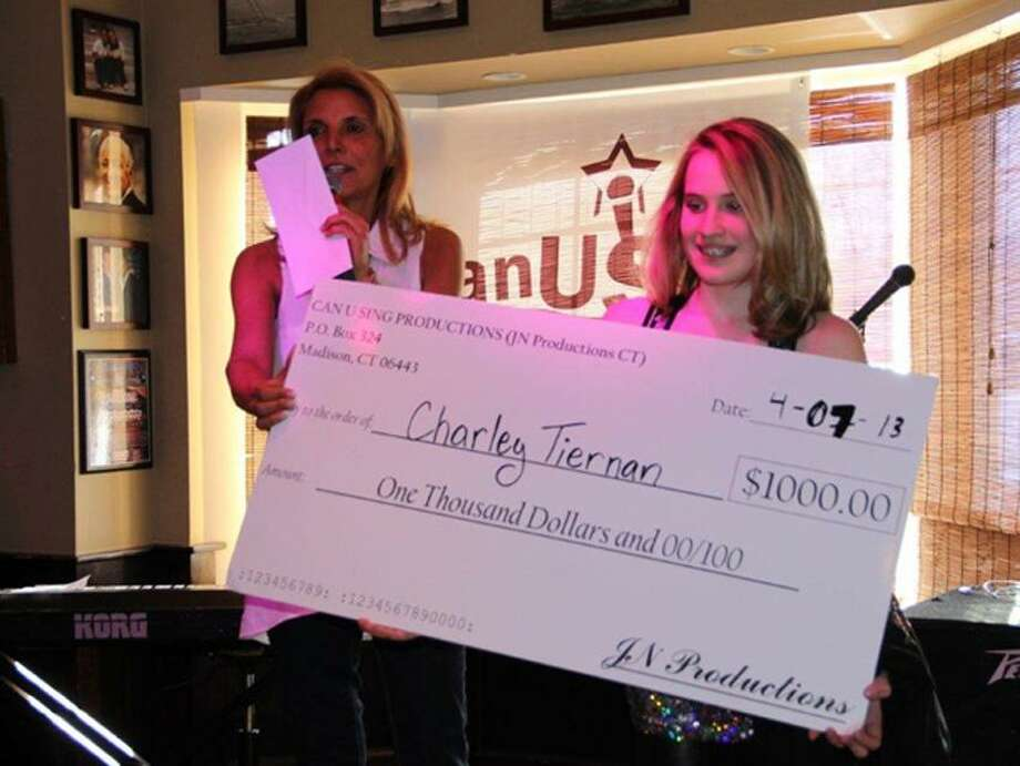 Producer Jill Nesi (left) presents the check to Charlie Tiernan, winner of the first Can U Sing competition. Contributed photo
