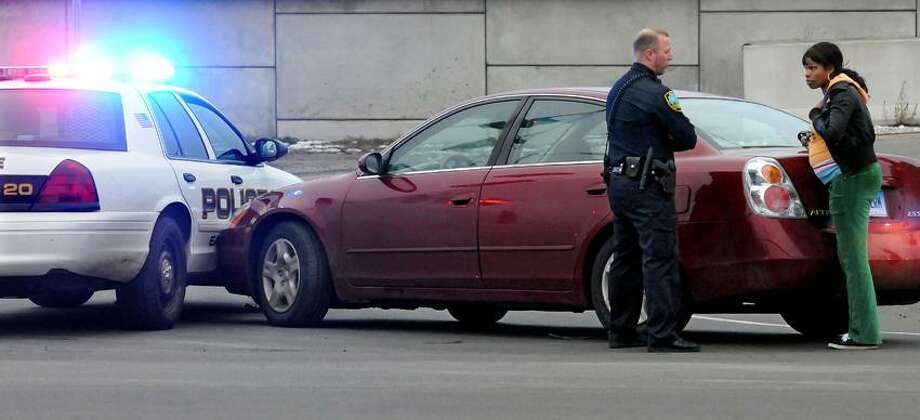 An East Haven cruiser and a car collided at the I-95 southbound entrance ramp on Sargent Dr. in New Haven.  Mara Lavitt/New Haven Register1/17/13