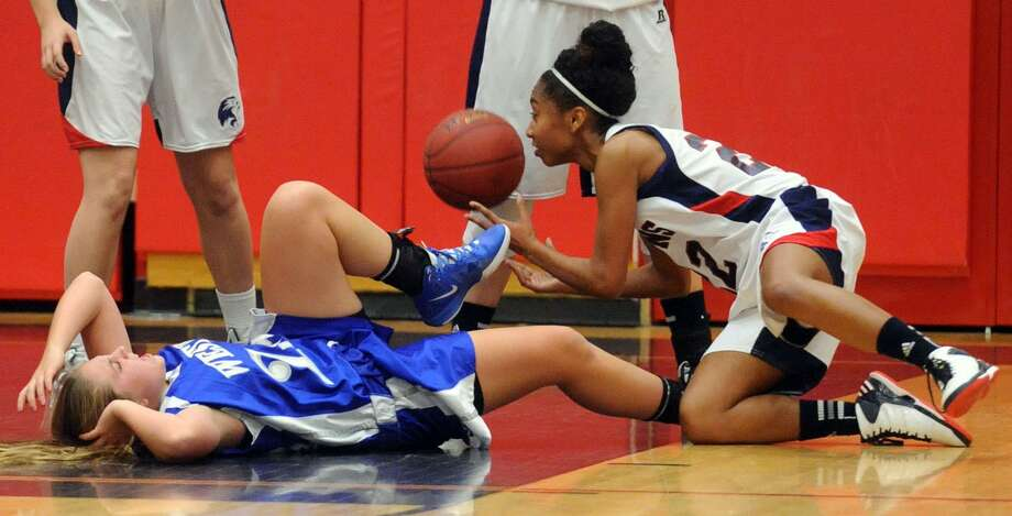 Foran's Teneya McLauglin, right, pictured here earlier this month against West Haven, helped the Lions beat win at Guilford 40-37 Friday night. Mara Lavitt/New Haven Register