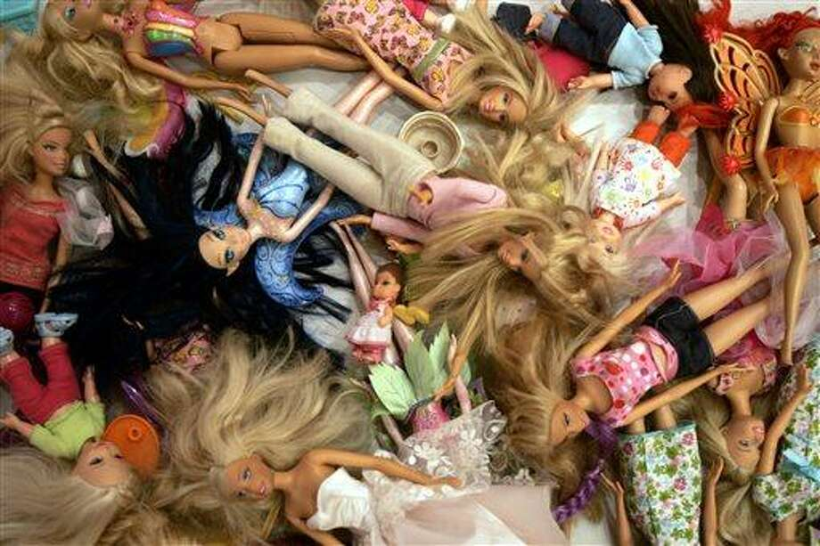 FILE - In this Oct. 31, 2007, file photo, Barbie dolls are seen at the Barbie Store in Buenos Aires. As Mattel reported on July 17, 2013, Barbie is suddenly facing a popularity contest as the most popular doll on the Market. Instead, Mattel's Monster High dolls, have exploded in popularity since being introduced in 2010.  (AP Photo/Natacha Pisarenko, file) Photo: AP / AP
