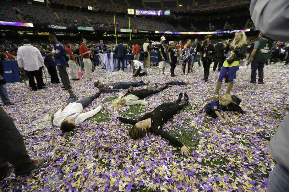 Fans are seen celebrating on the field after the NFL Super Bowl XLVII football game Sunday, Feb. 3, 2013, in New Orleans. (AP Photo/Julio Cortez) Photo: AP / AP