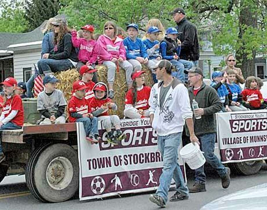 Kristin Clark/Dispatch Staff  Young athletes from Stockbridge Youth Sports ride on their float on Sunday in Munnsville.