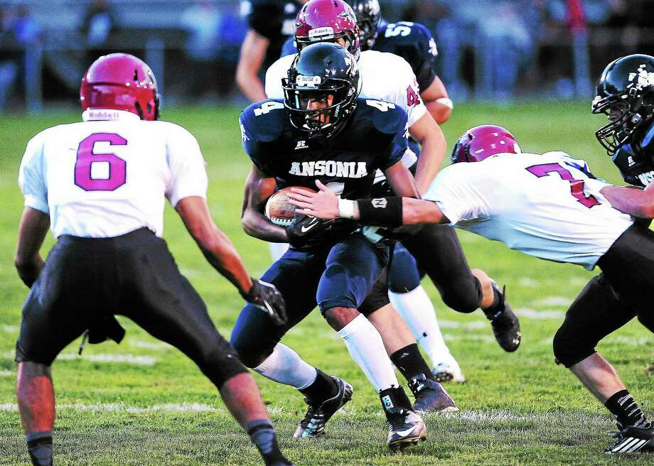 With a big win over Torrington last week, Tajik Bagley and Ansonia took over the top spot in the Register Top 10 poll. Photo: Peter Casolino — Register