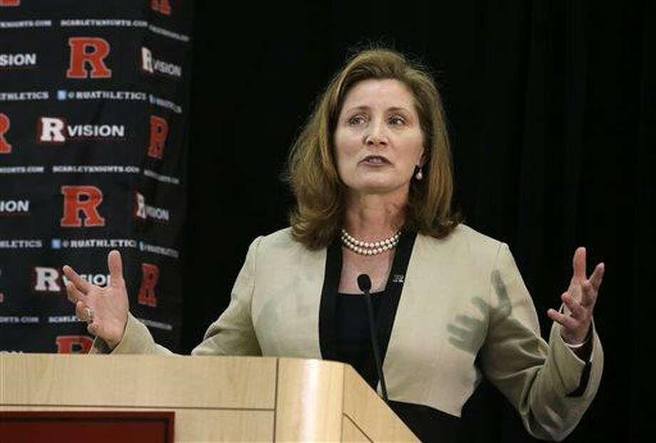 In this May 15, 2013 file photo, Julie Hermann speaks during a news conference where she was introduced as the new athletic director at Rutgers University, in Piscataway, N.J. Hermann, hired to clean up Rutgers' scandal-scarred athletic program, quit as Tennessee's women's volleyball coach 16 years ago after her players submitted a letter complaining she ruled through humiliation, fear and emotional abuse, The Star-Ledger reported Saturday, May 25, 2013, on its website. (AP Photo/Mel Evans, File) Photo: AP / AP