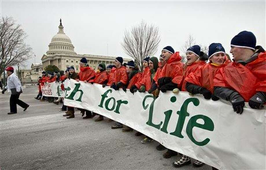 Anti-abortion activists march past the Capitol in Washington, Friday, Jan. 25, 2013, to the Supreme Court as they observe the 40th anniversary of the Roe v. Wade decision. Thousands of anti-abortion demonstrators marched through Washington to the steps of the U.S. Supreme Court to protest the landmark decision that legalized abortion.   (AP Photo/J. Scott Applewhite) Photo: AP / AP