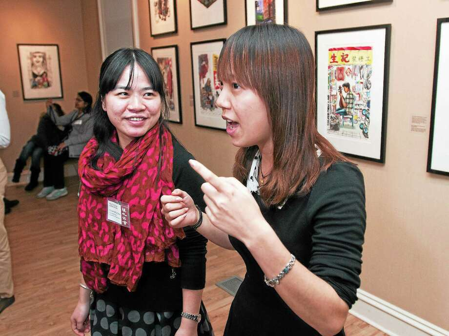 (Peter Casolino — New Haven Register)  Long Chuan, right, and Deng Haihui, both teachers from China talk about their teaching experiences during a reception at the Yale-China Association. The two Yale fellows are teaching in New Haven public schools for the year. Long Chuan is teaching at the Metropolitan Business Academy and Deng Haihui is teaching at Cooperative Arts and Humanities High School. pcasolino@NewHavenRegister Photo: Journal Register Co.