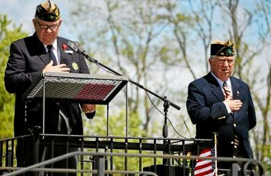 Tom Caprood/Register Citizen - Veterans John Lilley, left, and Maj. Kevin E. Creed, right, speak the Pledge of Allegiance during a Memorial Day Parade ceremony Sunday at Bantam Cemetery's All Wars Memorial.