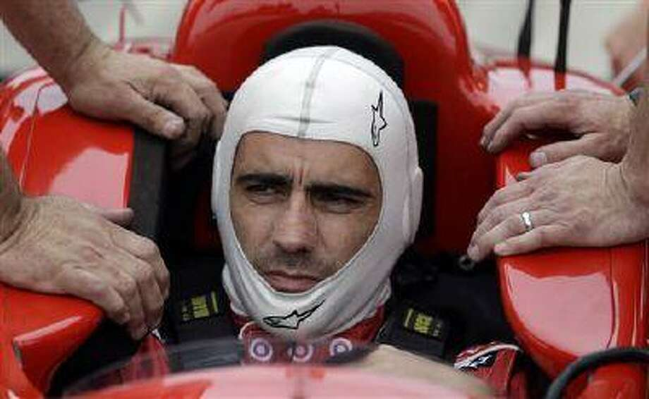 Dario Franchitti sits in his car as he prepares to drive during practice for the Indianapolis 500 at the Indianapolis Motor Speedway, May 17, 2013. Photo: AP / AP