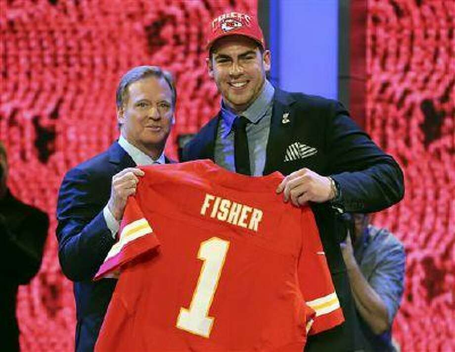 Tackle Eric Fisher from Central Michigan stands with NFL commissioner Roger Goodell after being selected first overall by the Kansas City Chiefs in the first round of the NFL draft, April 25, 2013 at Radio City Music Hall in New York. Photo: ASSOCIATED PRESS / AP2013