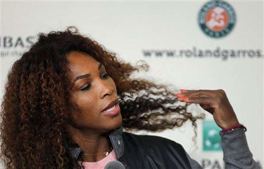Serena Williams of the United States adjusts her hair during a press conference for the 2013 French Open tennis tournament, at Roland Garros stadium in Paris, Friday May, 24, 2013. (AP Photo/Christophe Ena) Photo: AP / AP