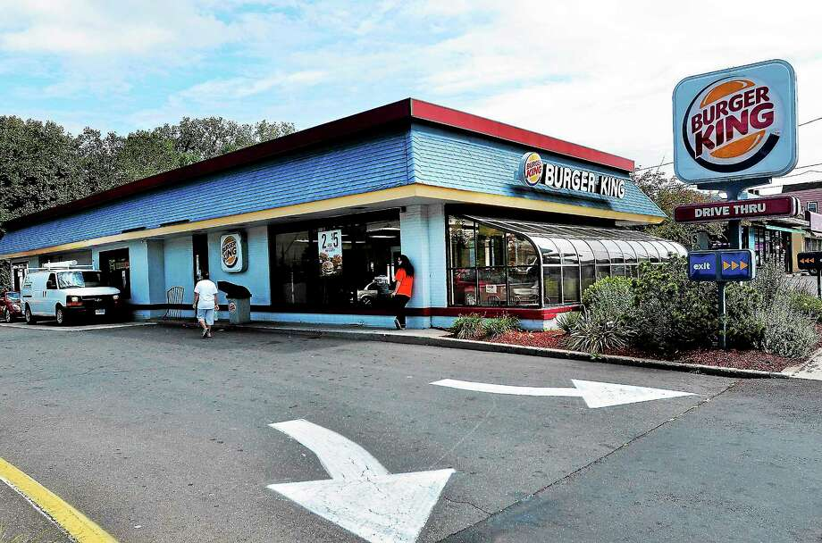 (Peter Casolino — New Haven Register)   The Burger King at 1329 Whalley Ave was open for lunch on Monday, following a robbery last night where a female employee was shot. 09/16/13 Photo: Journal Register Co.
