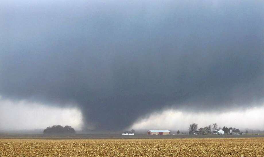 A tornado moves northeast Sunday, Nov. 17, 2013, two miles west of Flatville, Ill. The tornado damaged many farm buildings and homes on its way to Gifford, Ill., where scores of houses were devastated.  (AP Photo/News-Gazette, Jessie Starkey) MANDATORY CREDIT Photo: AP / News-Gazette