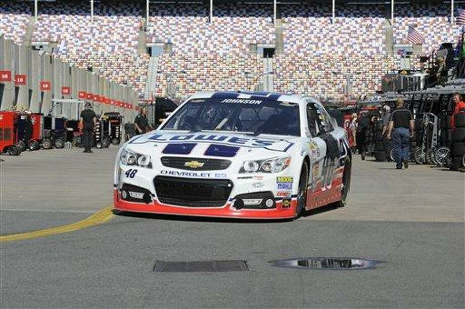 Jimmie Johnson drives his car out of the garage for practice for Sunday's NASCAR Sprint Cup series Coca-Cola 600 auto race at Charlotte Motor Speedway in Concord, N.C., Saturday, May 25, 2013. (AP Photo/Mike McCarn) Photo: AP / FR34342 AP
